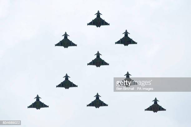 Eurofighter Typhoons fly in formation during the flypast at RAF Fairford as part of the Royal International Air Tattoo.