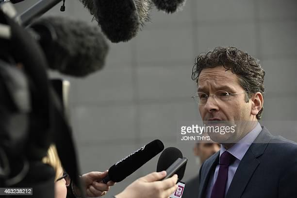 Eurogroup chairman Jeroen Dijsselbloem addresses reporters as he arrives for an emergency Eurogroup finance ministers meeting at the European Council...