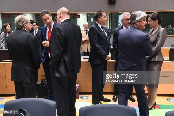 Eurogroup outgoing President Jeroen Dijsselbloem speaks with Italian Finance Minister Pier Carlo Padoan and German actingFinance Minister Peter...