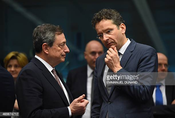Eurogroup President and Dutch Finance Minister Jeroen Dijsselbloem speaks with European Central Bank President Mario Draghi on March 9 2015 during a...