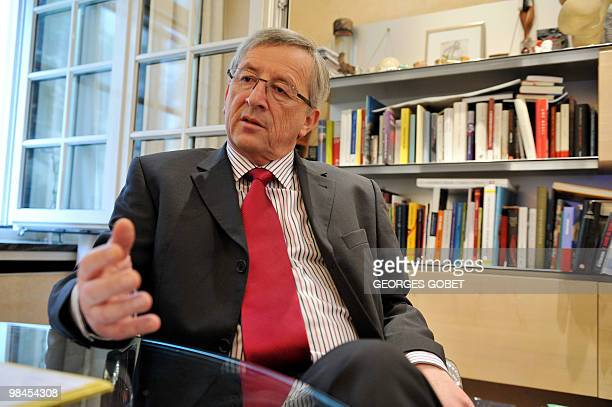Eurogroup president and Luxembourg Prime Minister JeanClaude Juncker listens to questions in his personal office on April 13 2010 in Luxemburg during...