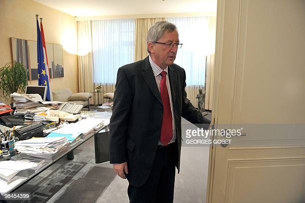 Eurogroup president and Luxembourg Prime Minister JeanClaude Juncker stands by the door in his personal office on April 13 2010 in Luxemburg during...