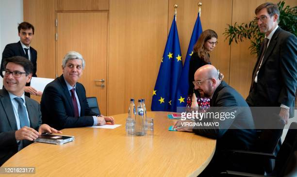 Eurogroup President and Portugal's Finance Minister Mario Centeno meets with European Council President Charles Michel at the Europa building in...