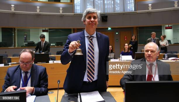 Eurogroup President and Portuguese Finance Minister Mario Centeno rings a bell as he chairs Eurogroup ministers' meeting in Brussels Beligum on March...