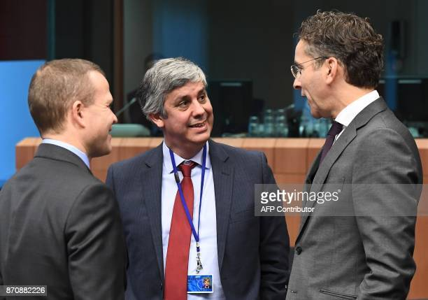 Eurogroup President Jeroen Dijsselbloem and Portugal's Finance Minister Mario Centeno attend an Eurogroup ministerial meeting at the European Council...