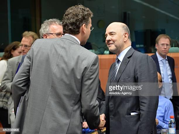 Eurogroup President Jeroen Dijsselbloem Finnish Finance Minister Alexander Stubb and European Commissioner for Economic and Financial Affairs Pierre...