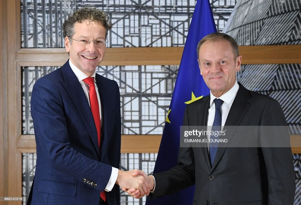 Eurogroup President Jeroen Dijsselbloem (L) shakes hands with European Council President Donald Tusk on December 4, 2017 at the European Council in Brussels. ?Eurozone finance ministers are due to decide on December 4 on a replacement for Eurogroup chief Jeroen Dijsselbloem, with four candidates in the running. /