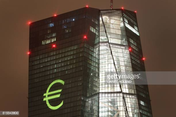 A Eurologo is projected onto the main building of the European Central Bank ECB during a rehearsal of the 'Luminale' in Frankfurt/Main Germany on...