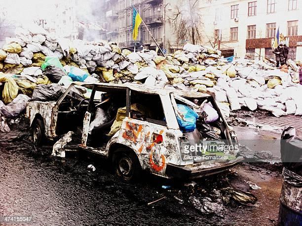 Euromaidan - Kiev, Ukraine Burned out car in Kiev, Ukraine