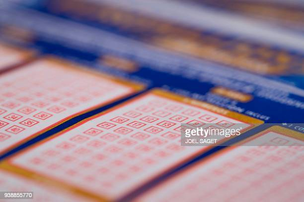Euromillions grids by Francaise des Jeux the operator of France's national lottery games are pictured on March 27 2018 in Paris
