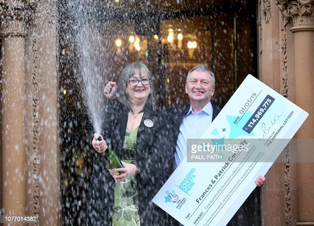 TOPSHOT EuroMillions lottery winners Frances and Patrick Connolly pose during a photocall at the Culloden Hotel near Belfast on January 4 after they...