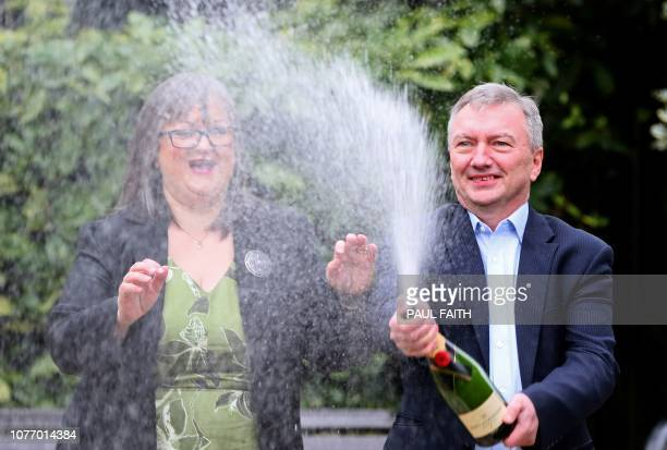EuroMillions lottery winners Frances and Patrick Connolly pose during a photocall at the Culloden Hotel near Belfast on January 4 after they were...