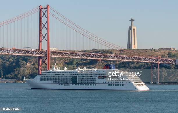 Europa 2 a cruise ship operated by HapagLloyd Cruises approaches 25 de Abril bridge while sailing on the Tagus River towards harbor on October 01...