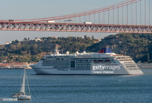 Europa 2 a cruise ship operated by HapagLloyd Cruises sails under 25 de Abril bridge on the Tagus River towards harbor on October 01 2018 in Lisbon...