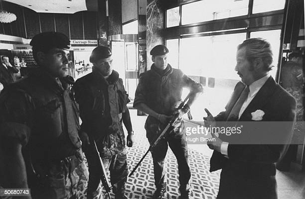 Europa Hotel manager Harper Brown talking with British soldiers who guard the hotel from bombings