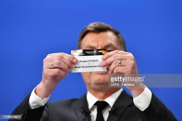 Europa League Ambassador Thomas Helmer draws out the card of FC Rangers FC/Bayer 04 Leverkusen during the UEFA Europa League 2019/20 Quarterfinal...