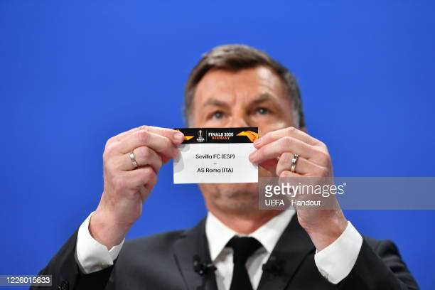 Europa League Ambassador Thomas Helmer draws out the card of Sevilla FC/AS Roma during the UEFA Europa League 2019/20 Quarterfinal Semifinal and...