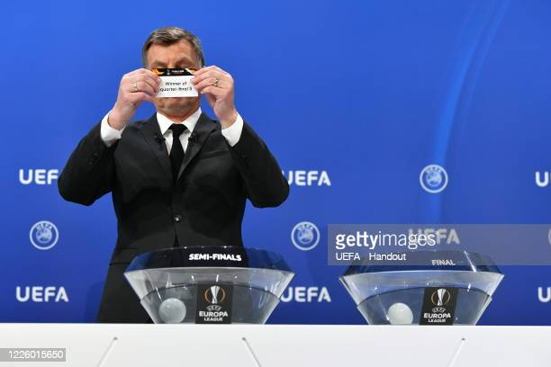 Europa League Ambassador Thomas Helmer draws out the card of 'Winner of quarterfinal 3' during the UEFA Europa League 2019/20 Quarterfinal Semifinal...