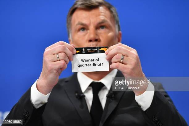 Europa League Ambassador Thomas Helmer draws out the card of 'Winner of quarterfinal 1' during the UEFA Europa League 2019/20 Quarterfinal Semifinal...