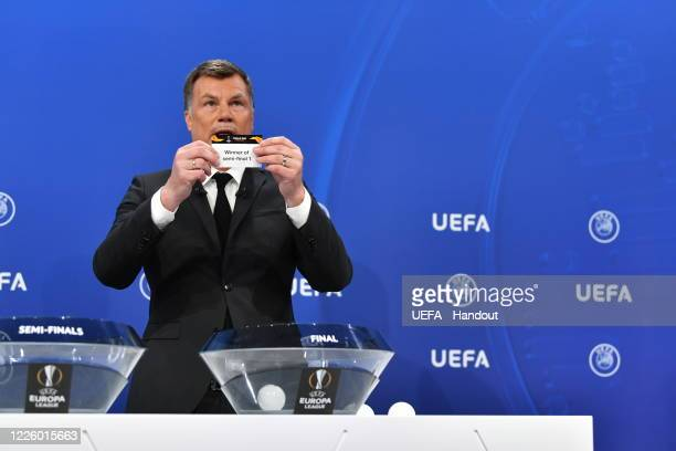 Europa League Ambassador Thomas Helmer draws out the card of 'Winner of semifinal 1' during the UEFA Europa League 2019/20 Quarterfinal Semifinal and...