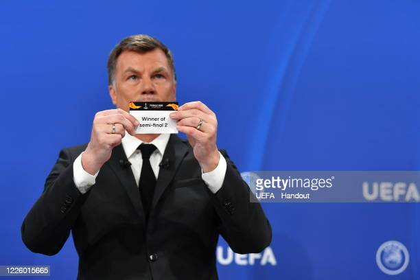 Europa League Ambassador Thomas Helmer draws out the card of 'Winner of semifinal 2' during the UEFA Europa League 2019/20 Quarterfinal Semifinal and...