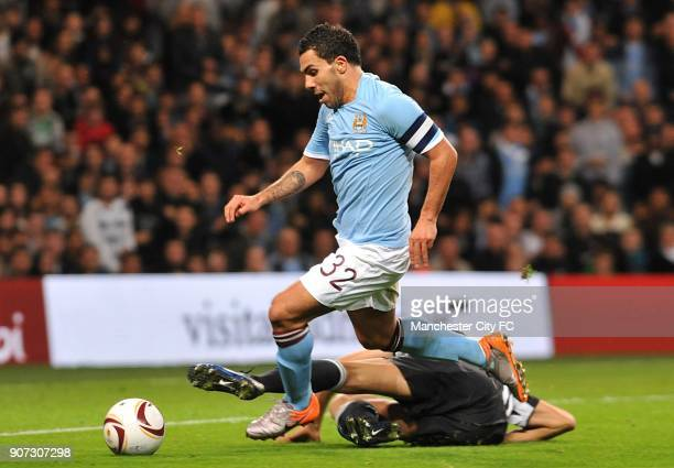 Europa League Group A Manchester City v Juventus City of Manchester Stadium Manchester City's Carlos Tevez is challenged by Juventus' Leonardo Bonucci