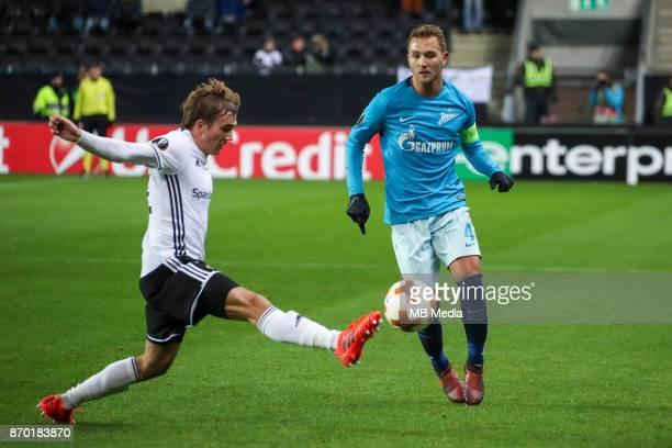 Rosenborg BK 11 Zenit St Petersburg Rosenborg's Morten Konradsen and Zenit St Petersburg's Domenico Criscito