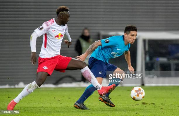 Europa League Round of 16 First leg Football match at RB Arena RB Leipzig 2 1 Zenit RB Leipzig's JeanKevin Augustin and Zenit St Petersburg's Matias...