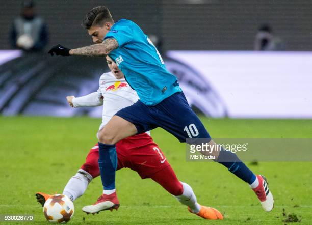 Europa League Round of 16 First leg Football match at RB Arena RB Leipzig 2 1 Zenit RB Leipzig's Marcel Sabitzer and Zenit St Petersburg's Emiliano...
