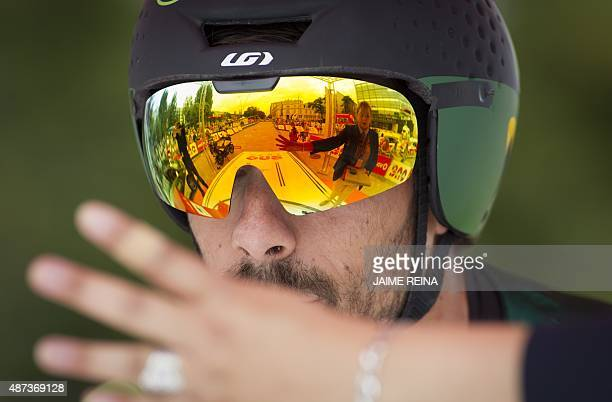 Europcar's French cyclist Jerome Cousin waits for the start of the 17th stage of the 2015 Vuelta Espana cycling tour a 387 km individual time trial...