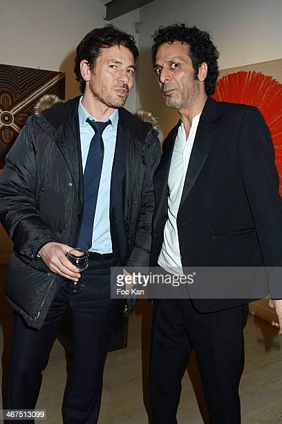Europe 1 journalist Alexandre Kara and Art Roch director Morteza Esmaili attend the '3 Events in 1 Night' Galerie Art Roch Launch Party At Galerie...