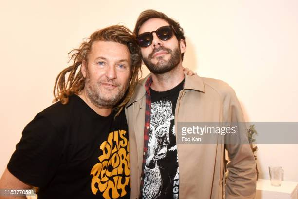 Europe 1 journalist Olivier Delacroix and singer Julien Doré's of band Darko attend Arnaud Giovaninetti Soleil Noir by Caroline Constant book signing...