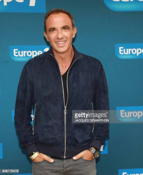 Europe 1 radio station journalist Nikos Aliagas poses within a backtowork season 20172018 press conference on September 12 2017 in Paris