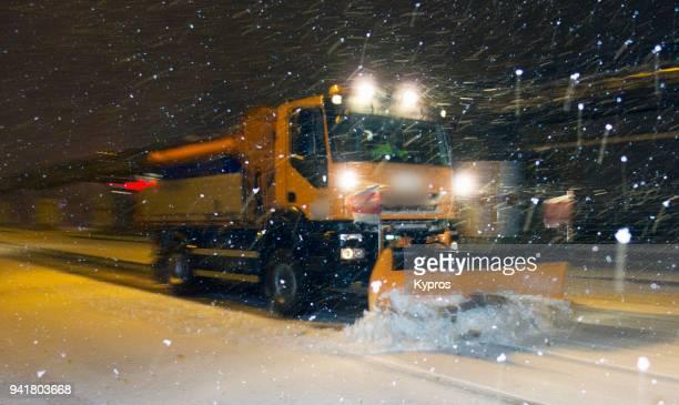 europe, austria, linz area, 2018: view of snow plow clearing road at night - schneefahrzeug stock-fotos und bilder