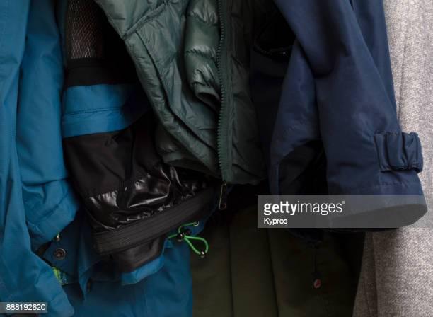 europe, austria, salzburg area, october 2017: view of clothes hanging is closet - フード付きコート ストックフォトと画像