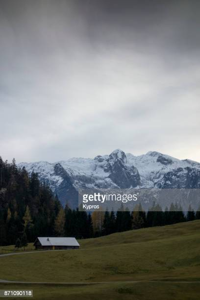 Europe, Austria, Salzburg Area, Tennengau, 2017: View Of Snow Capped Austrian Alps With Woodland Or Forest - This Mountain Range Is Thought To Be Either Tennengebirge (Tennen Mountains) Or Hagengebirge (Hagen Mountains)