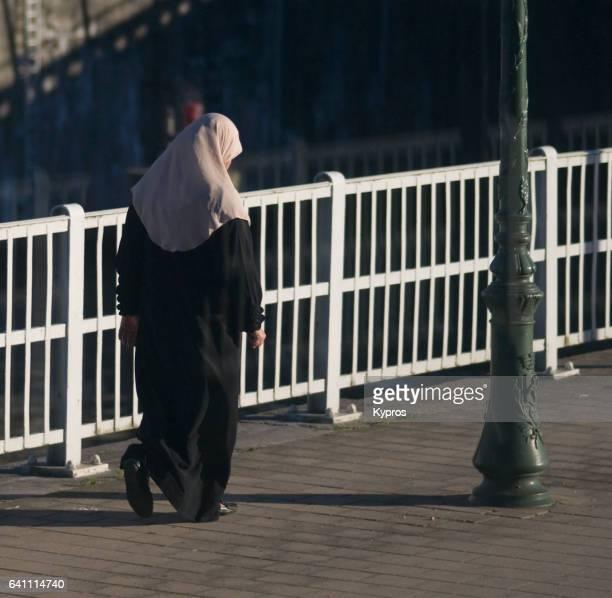 Europe, Belgium, Brussels, Rear View Of Muslim Woman Walking