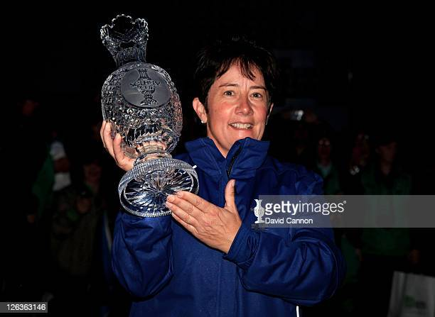 Europe Captain Alison Nicholas celebrates her team's 1513 victory with the trophy following the singles matches on day three of the 2011 Solheim Cup...
