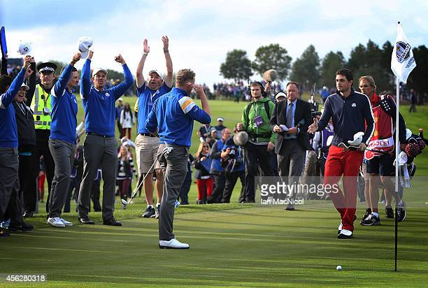 Europe celebrates as Keegan Bradley of USA concedes to Jamie Donaldson of Europe during the Singles Matches of the 2014 Ryder Cup on the PGA...