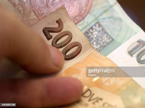 europe, czech republic, prague, view of person holding czech money (krone) - スウェーデン通貨 ストックフォトと画像