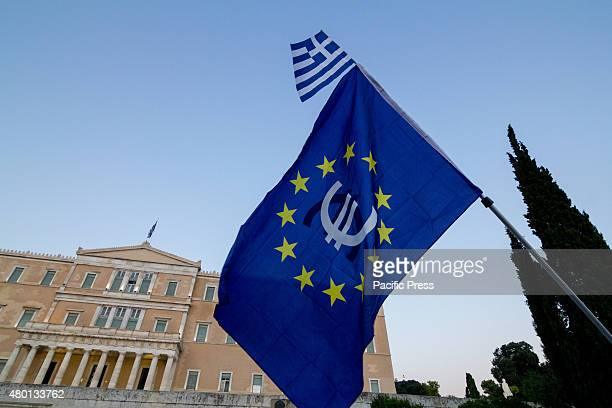 Europe flag with a Greek one are seen in front of the Parliament While the Greek government are negotiating with their creditors with the Grexit...
