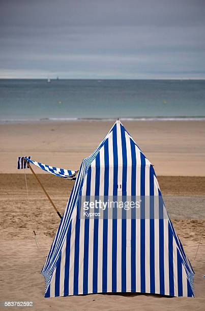 europe, france, brittany, dinard, traditional blue and white striped tent on beach - dinard stock pictures, royalty-free photos & images
