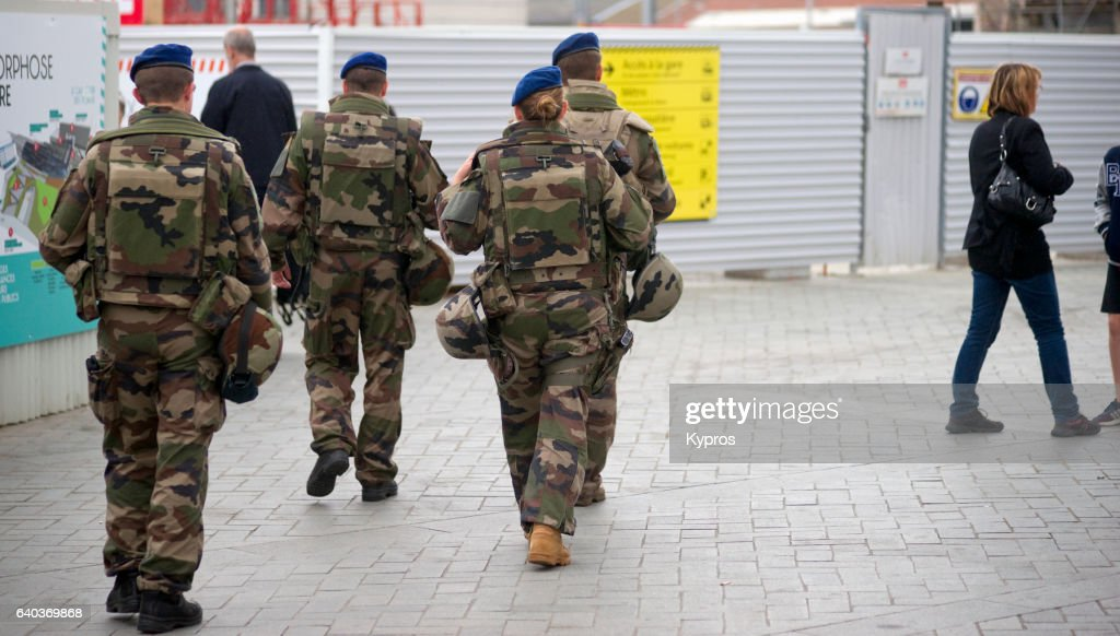 Europe, France, Brittany, Rennes, View Of Soldiers Patrolling Street Near Train Station : Photo