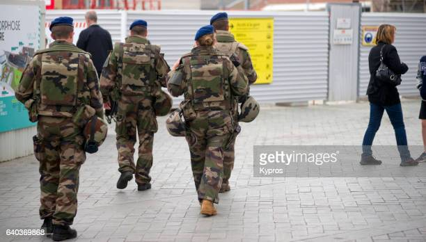 Europe, France, Brittany, Rennes, View Of Soldiers Patrolling Street Near Train Station