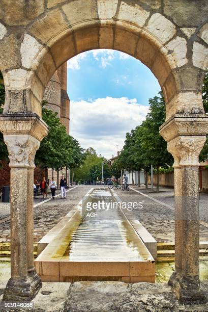 Europe France OccitanieTarn Albi city listed as World Heritage by UNESCO Sainte Cecile horseshoe arches and a basin in the courtyard of the apse of...