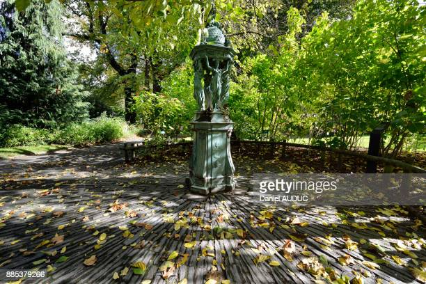 Europe, France, overall view of the Wallace fountain Caryatids and the Jardin des Plantes de Nantes