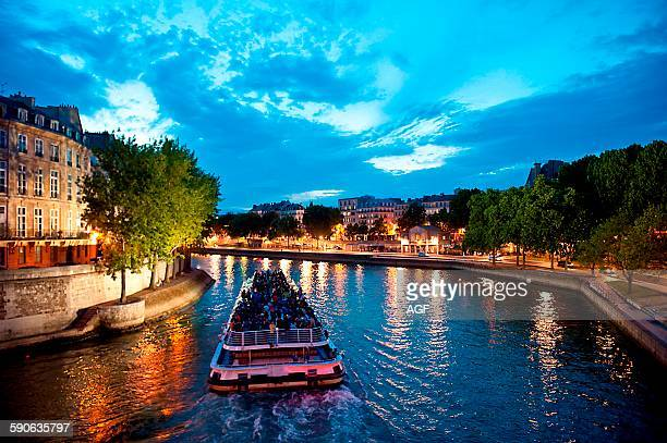 Europe France Paris Seine River at night with Notre Dame in background