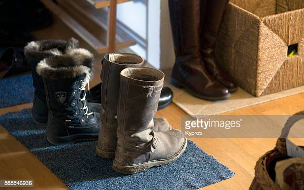 europe, germany, bavaria, munich, view of old leather riding boots in hallway - ブーツ ストックフォトと画像