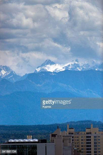 Europe, Germany, Bavaria, View Of Bavarian Alps With Munich Office Buildings