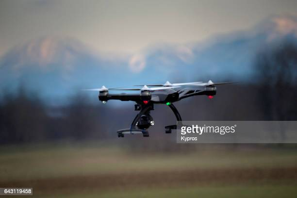 europe, germany, bavaria, view of drone flying (alps in background) - remote controlled stock photos and pictures
